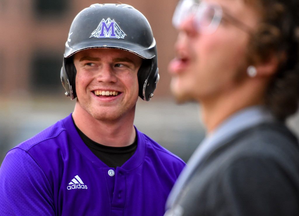 . Mountain View\'s Braden Barker laughs heading back to the dugout and the senior had plenty to smile about with 14 strikeouts in a complete-game shutout against rival Thompson Valley on Thursday April 5, 2018 at Brock Field. (Cris Tiller / Loveland Reporter-Herald)