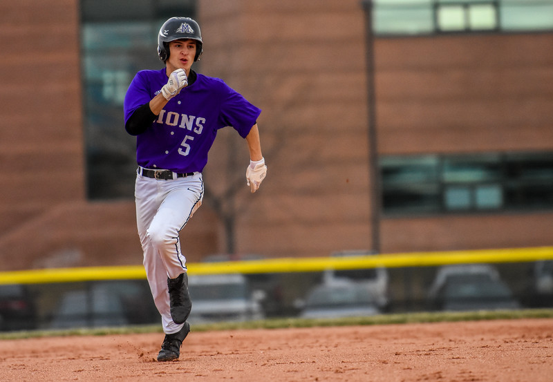 Mountain View's Tanner Cartmell rounds the bases against rival Thompson Valley on Thursday April 5, 2018 at Brock Field. (Cris Tiller / Loveland Reporter-Herald)