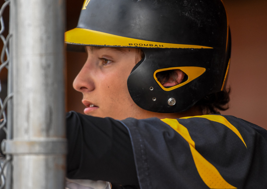 . Thompson Valley pitcher Jayden Raabe looks out from the dugout against rival Mountain View on Thursday April 5, 2018 at Brock Field. (Cris Tiller / Loveland Reporter-Herald)