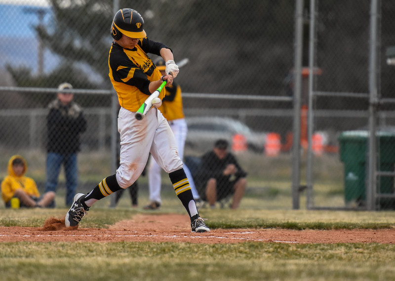 Thompson Valley's Tristan Schatz records on of the Eagles' two hits against rival Mountain View on Thursday April 5, 2018 at Brock Field. (Cris Tiller / Loveland Reporter-Herald)