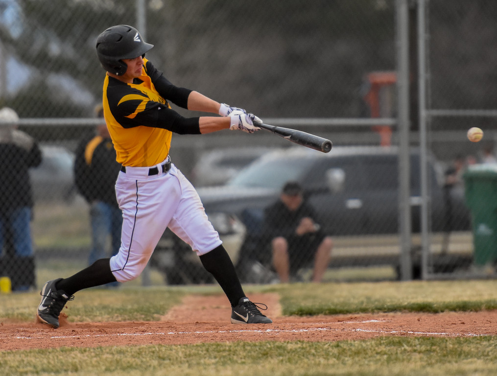 . Thompson Valley\'s Cameron Nellor rips a single, one of two hits for the Eagles against rival Mountain View on Thursday April 5, 2018 at Brock Field. (Cris Tiller / Loveland Reporter-Herald)