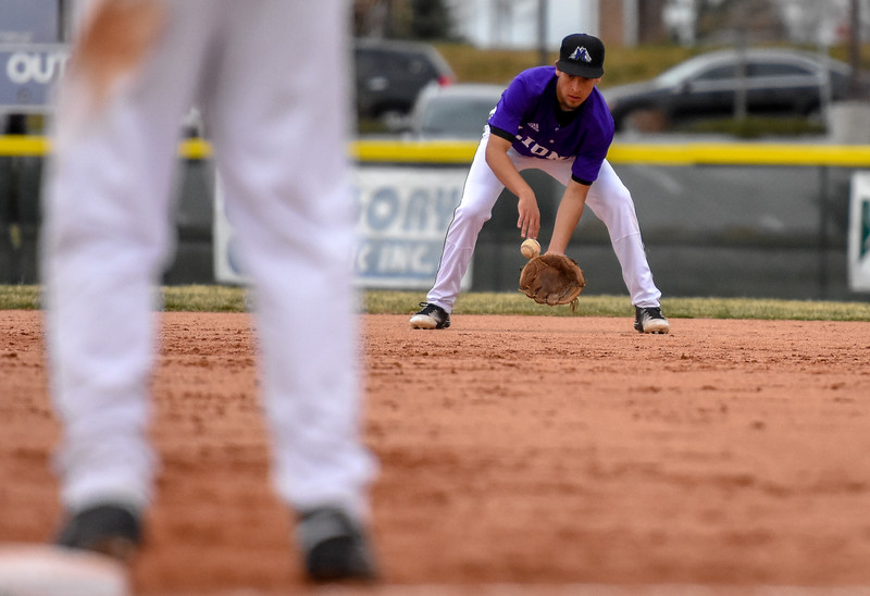 Mountain View second baseman TJ Mendoza fields a ground ball against Thompson Valley on Thursday April 5, 2018 at Brock Field. (Cris Tiller / Loveland Reporter-Herald)