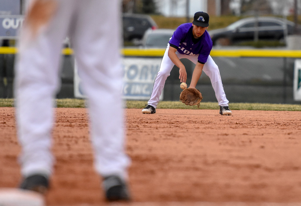 . Mountain View second baseman TJ Mendoza fields a ground ball against Thompson Valley on Thursday April 5, 2018 at Brock Field. (Cris Tiller / Loveland Reporter-Herald)