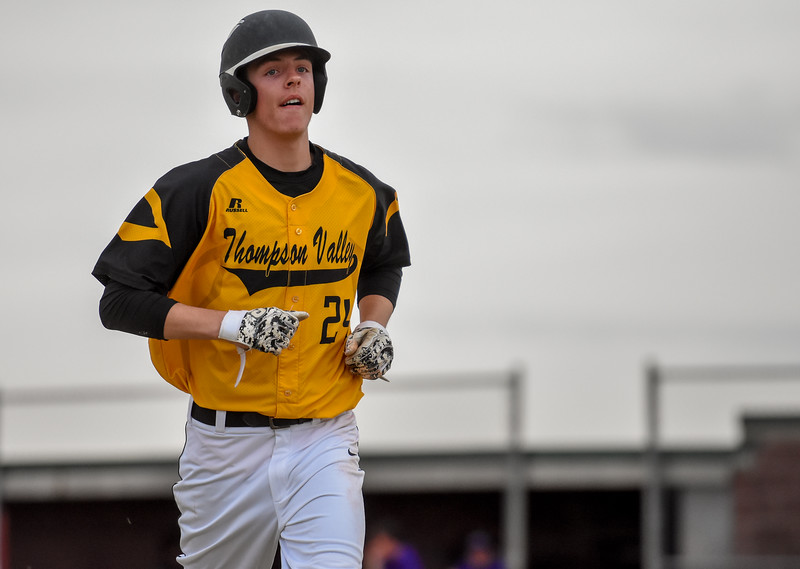 Thompson Valley's Trey Kreikemaier returns to the dugout after getting picked off at first base against rival Mountain View on Thursday April 5, 2018 at Brock Field. (Cris Tiller / Loveland Reporter-Herald)