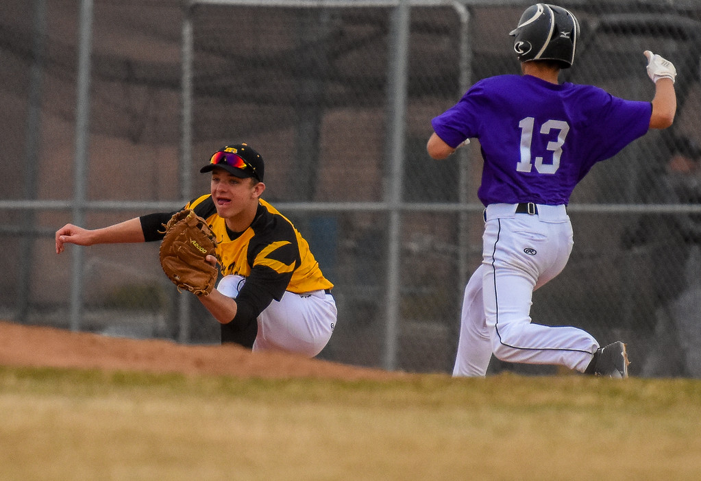 . Thompson Valley first baseman Cameron Nellor makes an out against rival Mountain View on Thursday April 5, 2018 at Brock Field. (Cris Tiller / Loveland Reporter-Herald)