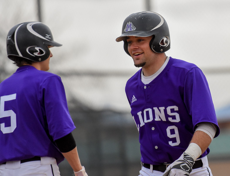 Mountain View's Mike Felton comes back to the dugout all smiles against Thompson Valley on Thursday April 5, 2018 at Brock Field. (Cris Tiller / Loveland Reporter-Herald)