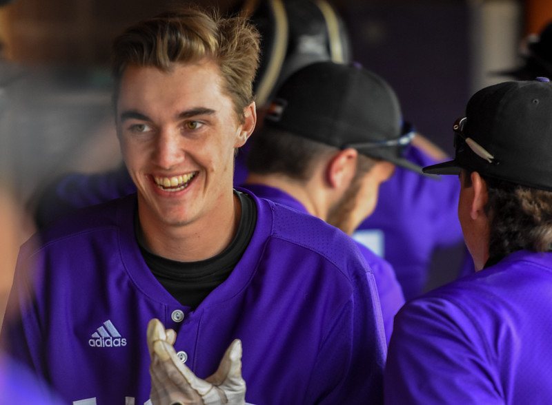 Mountain View's Shane Shadowen smiles in the dugout after scoring a run against rival Thompson Valley on Thursday April 5, 2018 at Brock Field. (Cris Tiller / Loveland Reporter-Herald)
