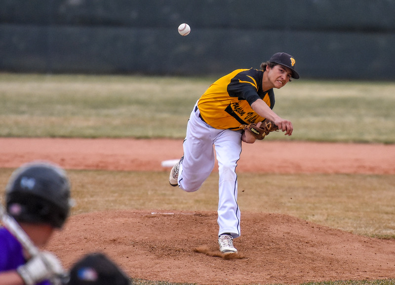 Thompson Valley pitcher Jayden Raabe delivers a strike against rival Mountain View on Thursday April 5, 2018 at Brock Field. (Cris Tiller / Loveland Reporter-Herald)