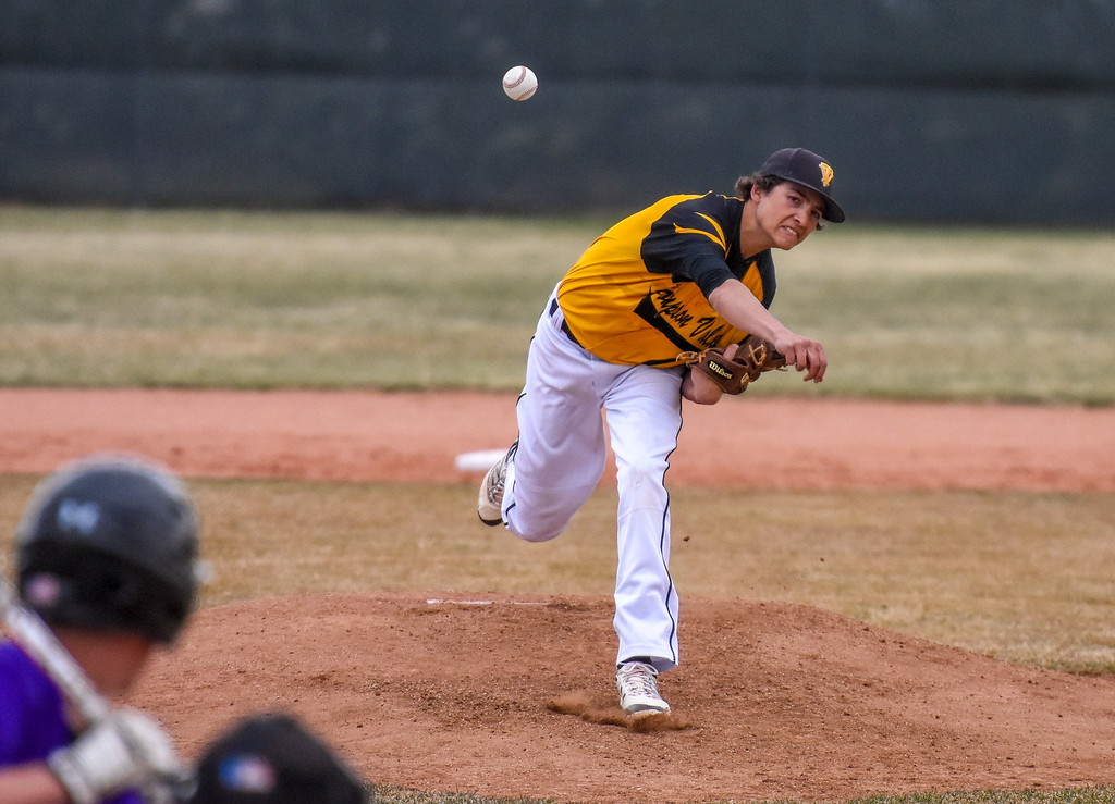 . Thompson Valley pitcher Jayden Raabe delivers a strike against rival Mountain View on Thursday April 5, 2018 at Brock Field. (Cris Tiller / Loveland Reporter-Herald)