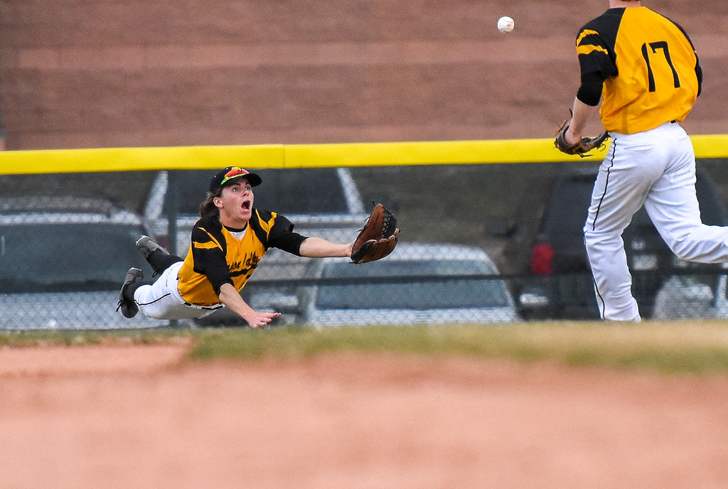 . Thompson Valley outfielder Seth Dotson lays out to try a diving catch against rival Mountain View on Thursday April 5, 2018 at Brock Field. (Cris Tiller / Loveland Reporter-Herald)