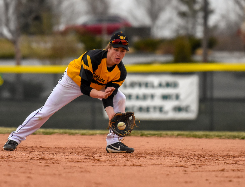 Thompson Valley second baseman Jarret Riehl fields a ground ball against rival Mountain View on Thursday April 5, 2018 at Brock Field. (Cris Tiller / Loveland Reporter-Herald)