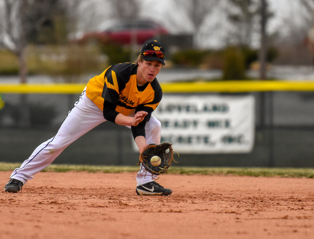 . Thompson Valley second baseman Jarret Riehl fields a ground ball against rival Mountain View on Thursday April 5, 2018 at Brock Field. (Cris Tiller / Loveland Reporter-Herald)