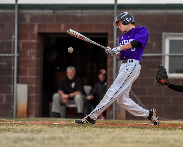 Mountain View's Christian Patrick ropes a triple against rival Thompson Valley on Thursday April 5, 2018 at Brock Field. (Cris Tiller / Loveland Reporter-Herald)