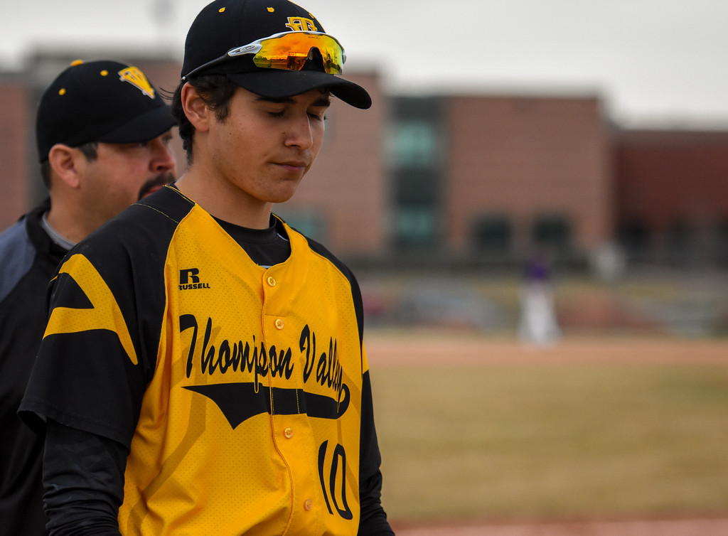 . Thompson Valley senior Adrian Juarez comes back disgusted to the dugout after a big inning from rival Mountain View on Thursday April 5, 2018 at Brock Field. (Cris Tiller / Loveland Reporter-Herald)