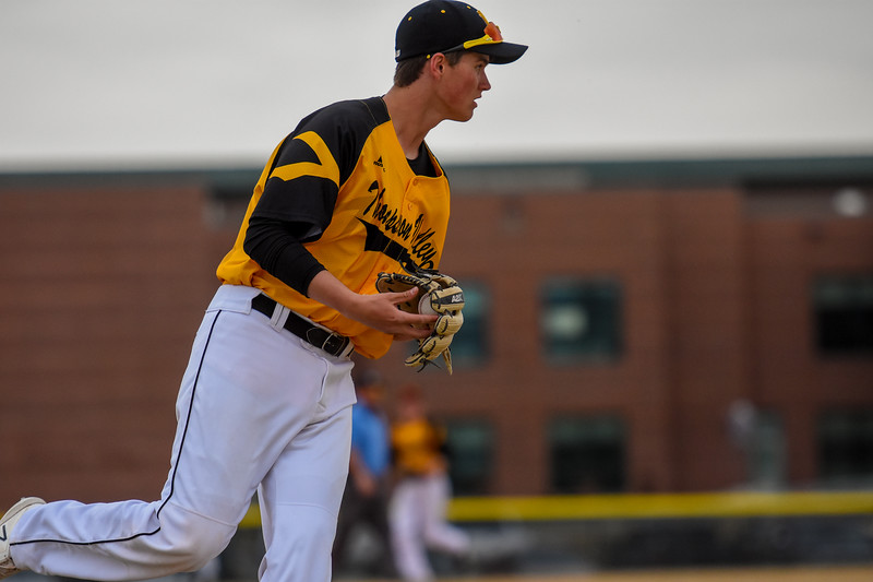 Thompson Valley third baseman Aidan Schultz eyes a throw against rival Mountain View on Thursday April 5, 2018 at Brock Field. (Cris Tiller / Loveland Reporter-Herald)