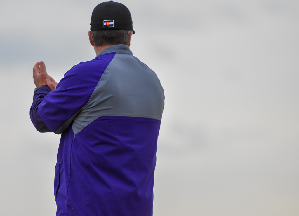 . Mountain View coach Brian Smela claps after a big hit against rival Thompson Valley on Thursday April 5, 2018 at Brock Field. (Cris Tiller / Loveland Reporter-Herald)