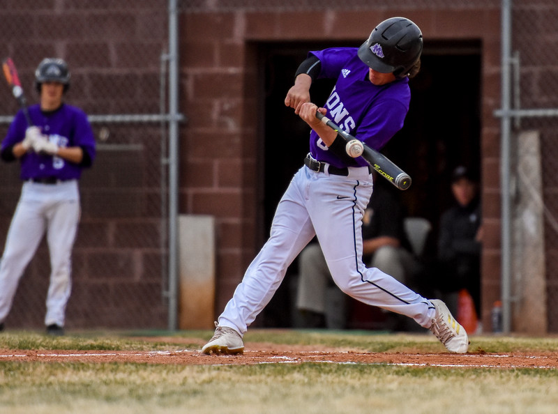 Mountain View's Chad Baumann hits the ball against rival Thompson Valley on Thursday April 5, 2018 at Brock Field. (Cris Tiller / Loveland Reporter-Herald)
