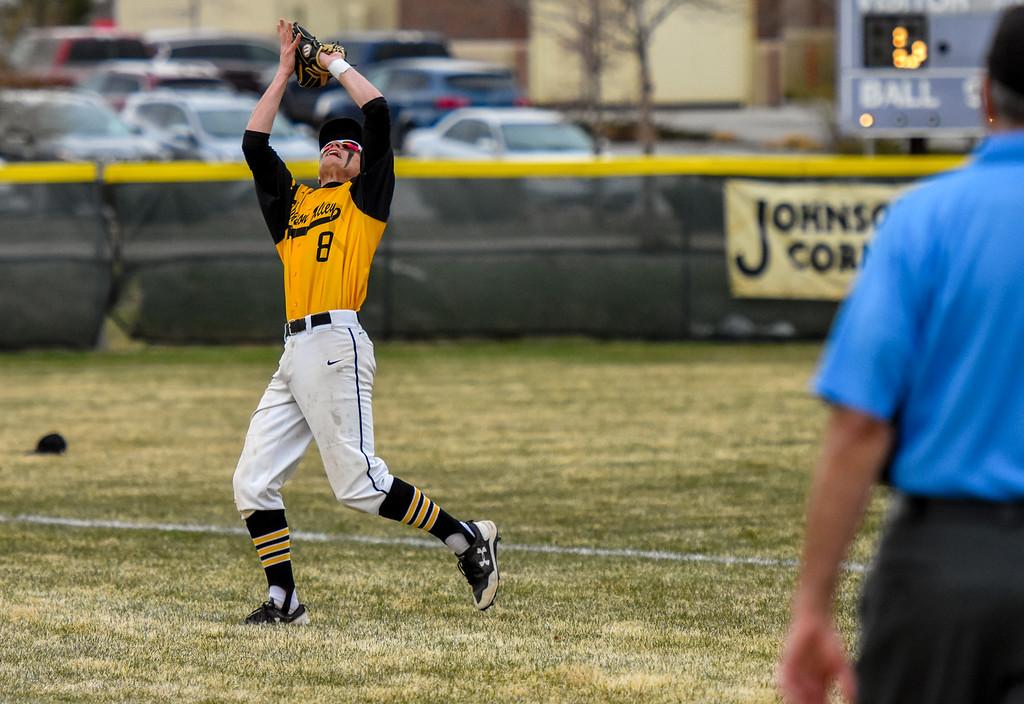 . Thompson Valley shortstop Austin Sobraske ranges for a catch against rival Mountain View on Thursday April 5, 2018 at Brock Field. (Cris Tiller / Loveland Reporter-Herald)