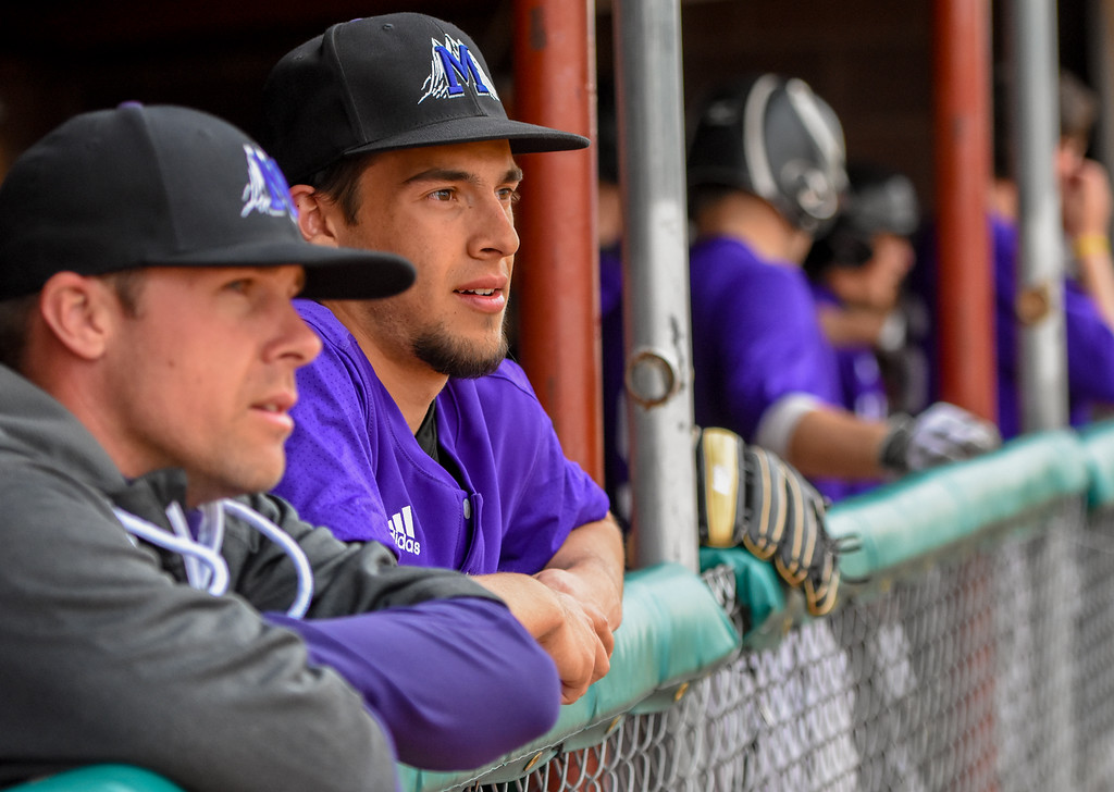 . Mountain View\'s TJ Mendoza looks out from the dugout against Thompson Valley on Thursday April 5, 2018 at Brock Field. (Cris Tiller / Loveland Reporter-Herald)