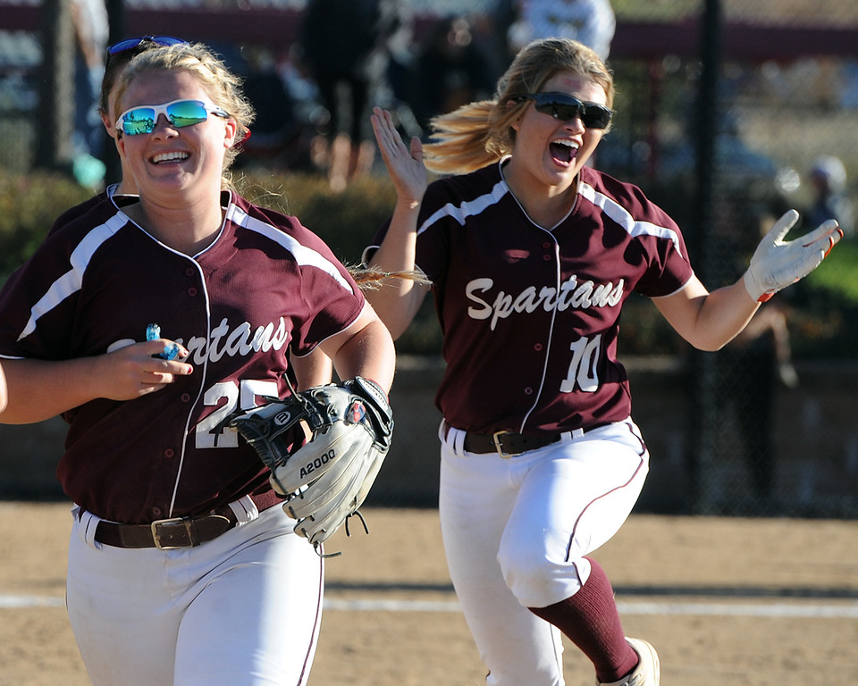 . Berthoud\'s Sarah Jorissen, left, and Carly Rafferty celebrate their win over top-seeded Pueblo County during the first day of the 4A state softball tournament on Friday, Oct. 19, 2018 at Aurora Sports Park. (Sean Star/Loveland Reporter-Herald)