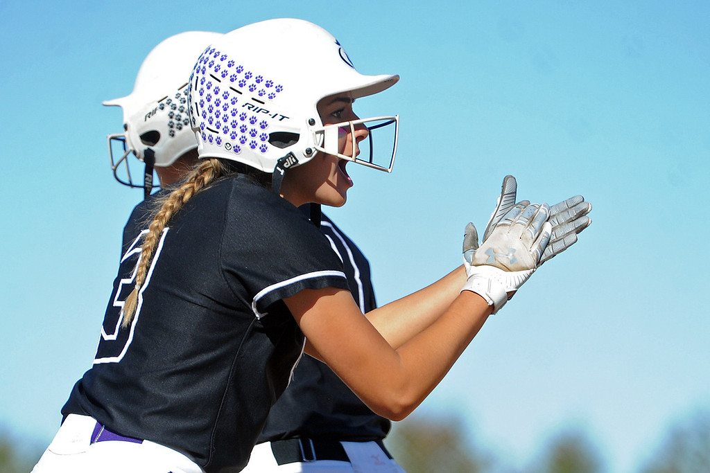 . Mountain View\'s Jaelyn Taylor applauds a teammate after scoring a run during the first day of the 4A state softball tournament on Friday, Oct. 19, 2018 at Aurora Sports Park. (Sean Star/Loveland Reporter-Herald)
