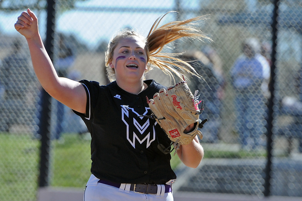 . Mountain View\'s Bailey Carlson high-fives a teammate between innings during the first day of the 4A state softball tournament on Friday, Oct. 19, 2018 at Aurora Sports Park. (Sean Star/Loveland Reporter-Herald)