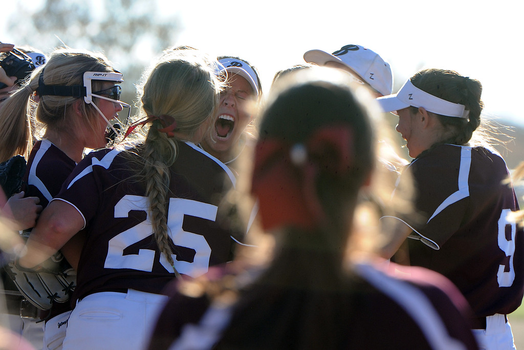 . Berthoud celebrates its win over top-seeded Pueblo County on the first day of the 4A state softball tournament on Friday, Oct. 19, 2018 at Aurora Sports Park. (Sean Star/Loveland Reporter-Herald)