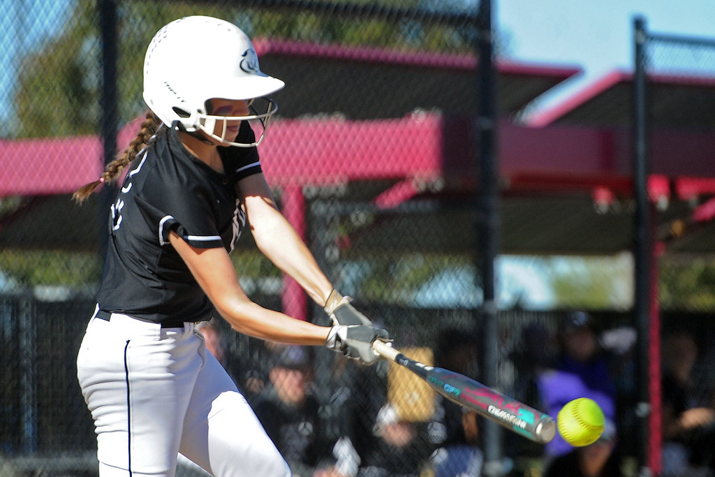. Mountain View\'s Michelle Pomranka makes contact during the first day of the 4A state softball tournament on Friday, Oct. 19, 2018 at Aurora Sports Park. (Sean Star/Loveland Reporter-Herald)