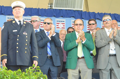 KYLE MENNIG - ONEIDA DAILY DISPATCH National Baseball Hall of Famers give New York City Battalion Fire Chief Vin Mavaro, left, a standing ovation at the National Baseball Hall of Fame Induction Ceremony in Cooperstown on Sunday, July 24, 2016.