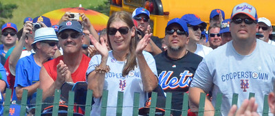 KYLE MENNIG - ONEIDA DAILY DISPATCH New York Mets fans cheer during Mike Piazza's speech at the National Baseball Hall of Fame Induction Ceremony in Cooperstown on Sunday, July 24, 2016.