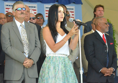 KYLE MENNIG - ONEIDA DAILY DISPATCH Alexandra Fassler, a singer and actress originally from Oneonta, sings the national anthem at the National Baseball Hall of Fame Induction Ceremony in Cooperstown on Sunday, July 24, 2016.
