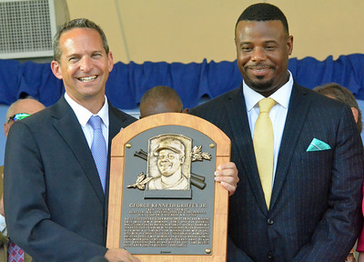 KYLE MENNIG - ONEIDA DAILY DISPATCH National Baseball Hall of Fame President Jeff Idelson, left, and Ken Griffey Jr. hold Griffey's plaque during the National Baseball Hall of Fame Induction Ceremony in Cooperstown on Sunday, July 24, 2016.
