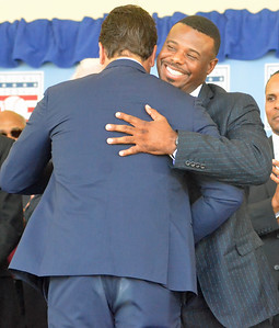 KYLE MENNIG - ONEIDA DAILY DISPATCH Ken Griffey Jr. hugs Mike Piazza after Piazza gave his speech at the National Baseball Hall of Fame Induction Ceremony in Cooperstown on Sunday, July 24, 2016.