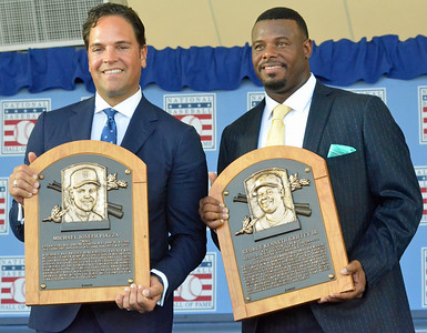 KYLE MENNIG - ONEIDA DAILY DISPATCH Mike Piazza, left, and Ken Griffey Jr. hold up their plaques after the National Baseball Hall of Fame Induction Ceremony in Cooperstown on Sunday, July 24, 2016.