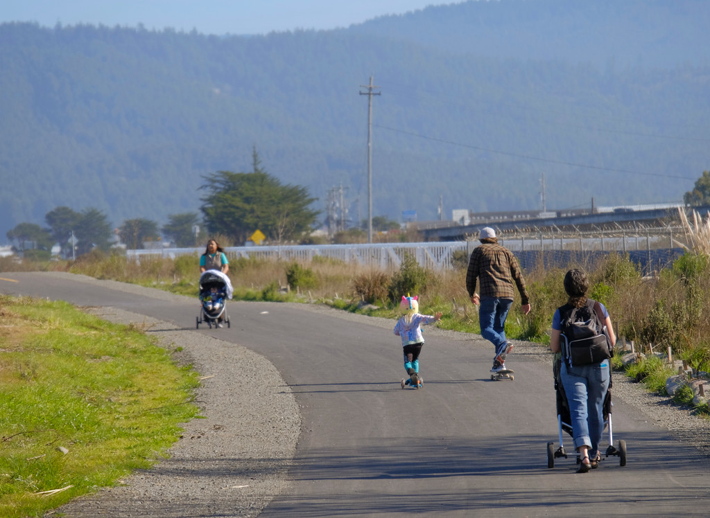 . Shaun Walker � The Times-Standard  People roll and walk along between Target and Blue Ox Millworks after a ribbon ceremony to officially open the newly completed Eureka Waterfront Trail on Tuesday. The section behind Blue Ox, which stretches from near the Samoa Bridge to Tydd Street next to Open Door Community Health Center, is the most recent and final section to be completed. Eureka gulch trails are planned, and a connection to the Humboldt Bay Trail in Arcata along Highway 101 may be made in 2021.