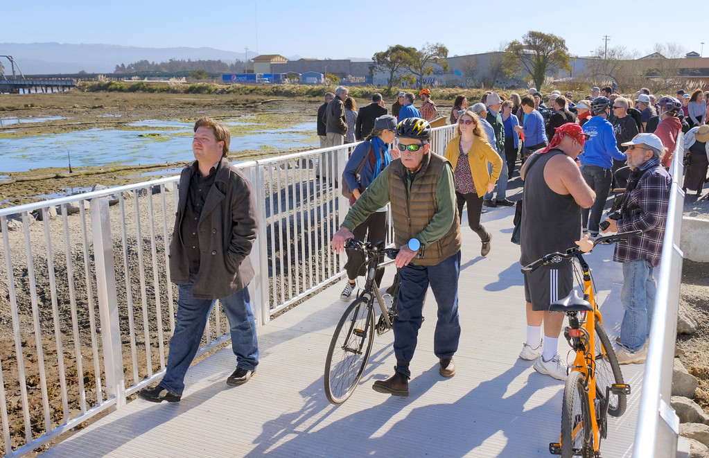 . Shaun Walker � The Times-Standard  People enjoy the raised boardwalk net to a new wetland area after a ribbon ceremony to officially open the newly completed Eureka Waterfront Trail on Tuesday behind Blue Ox Millworks and Historical Park. The section behind Blue Ox, which stretches from near the Samoa Bridge to Tydd Street next to Open Door Community Health Center, is the most recent and final section to be completed. Eureka gulch trails are planned, and a connection to the Humboldt Bay Trail in Arcata along Highway 101 may be made in 2021.