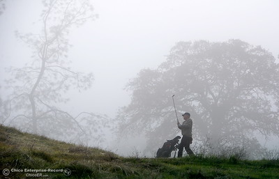 A golfer tries to keep his ball in sight on a foggy morning for golf in Upper Bidwell Park in Chico, Calif.  Monday Dec. 12, 2016. (Bill Husa -- Enterprise-Record)