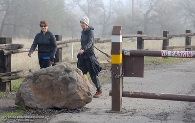 "Dede Ferris left and Kathleen Pappani of Chico enjoy a hike near the gate to Upper Bidwell Park by Horseshoe Lake Monday Dec. 12, 2016. Ferris said ""I like it closed five days at least"" while Pappani said ""I have a very strong opinion about this road, I think weekends should be closed personally. I think environmentally it's just wrong."" (Bill Husa -- Enterprise-Record)"