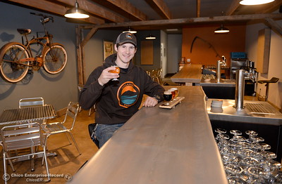 Brewer Dane Packard holds up a Norcal Common as he sits with a flight of beers at the Waganupa Brewing Co. located near the Beauty School on Longfellow Ave. in Chico, Calif. Thurs. Dec. 15, 2016. (Bill Husa -- Enterprise-Record)