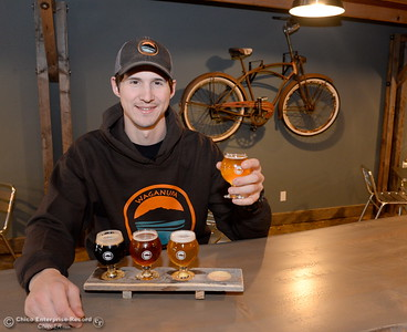 Brewer Dane Packard holds up a Norcal Common as he shows off a flight of beers at Waganupa Brewing Co. located near the Beauty School on Longfellow Ave. in Chico, Calif. Thurs. Dec. 15, 2016. (Bill Husa -- Enterprise-Record)