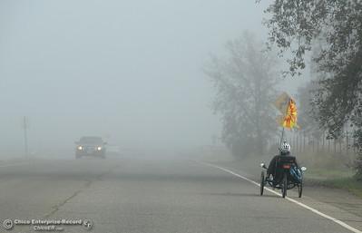 A cyclist rides through the fog in Upper Bidwell Park, Chico, Calif. Monday Dec. 12, 2016. (Bill Husa -- Enterprise-Record)