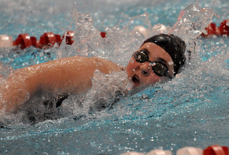 Mountain View's Grace Peterson swims the 100-yard freestyle during the Northern Conference Championships on Saturday Feb. 3, 2018 at the VMAC in Thornton. Peterson placed seventh. (Cris Tiller / Loveland Reporter-Herald)