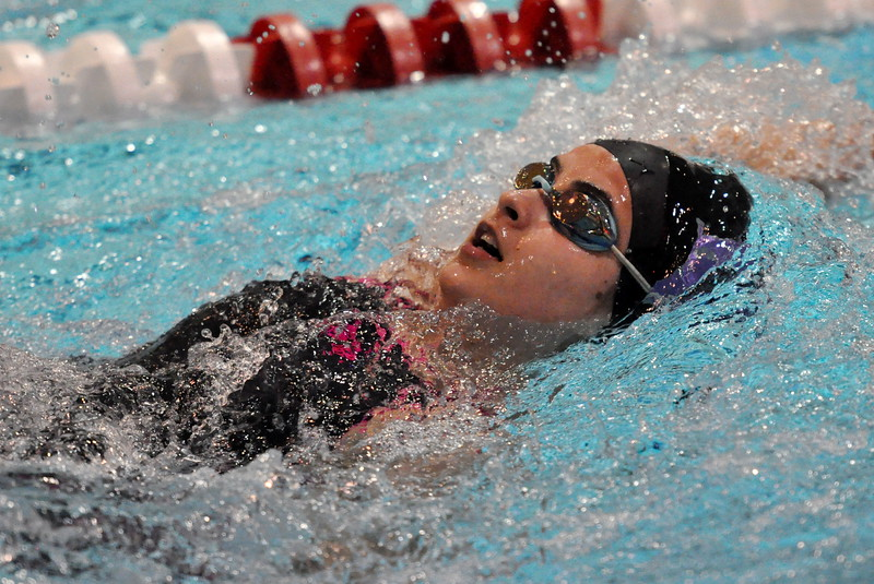 Mountain View's Sophie Busse swims the backstroke portion of her 200 IM during the Northern Conference Championships on Saturday Feb. 3, 2018 at the VMAC in Thornton. (Cris Tiller / Loveland Reporter-Herald)