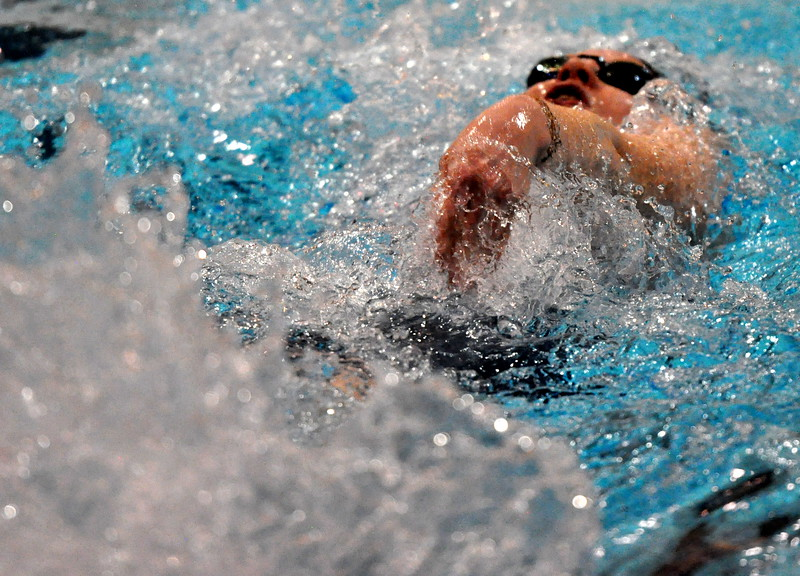Mountain View's Tasha Reichhardt swims the 100-yard backstroke during the Northern Conference Championships on Saturday Feb. 3, 2018 at the VMAC in Thornton. (Cris Tiller / Loveland Reporter-Herald)