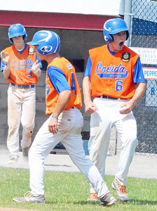 KYLE MENNIG - ONEIDA DAILY DISPATCH Oneida Post's Henry Froass (6) reacts after scoring the go-ahead run against Clinton County during their game in the American Legion Junior Baseball state tournament in Rome on Friday, July 29, 2016.