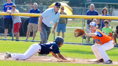 KYLE MENNIG - ONEIDA DAILY DISPATCH Fort Orange Post's Nicholas Esparra (46) dives safely back into first as Oneida Post's Danny Myatt (16) awaits a pickoff throw during their game in the American Legion Junior Baseball state tournament in Rome on Friday, July 29, 2016.
