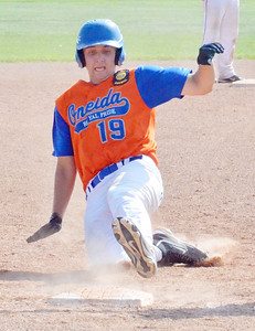 KYLE MENNIG - ONEIDA DAILY DISPATCH Oneida Post's Zach LaQuay slides safely into third against Clinton County during their game in the American Legion Junior Baseball state tournament in Rome on Friday, July 29, 2016.