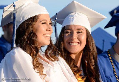 A pair of graduates smile as the class of 2016 celebrates Orland High School's 120th year at Roosevelt Field on the Orland High School campus Friday June 3, 2016. (Bill Husa -- Enterprise-Record)