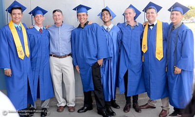 A group of 2016 graduates smile as they get ready to celebrate Orland High School's 120th year at Roosevelt Field on the Orland High School campus Friday June 3, 2016. (Bill Husa -- Enterprise-Record)