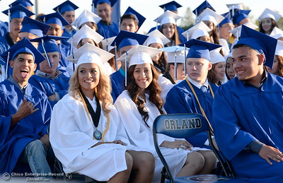 Graduates smile as the class of 2016 celebrates Orland High School's 120th year at Roosevelt Field on the Orland High School campus Friday June 3, 2016. (Bill Husa -- Enterprise-Record)